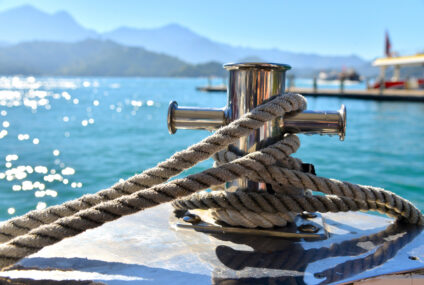 MOORING SYSTEMS AND FLOATING DOCKS